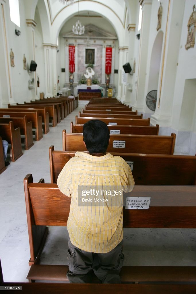 A man prays in Our Lady of Guadalupe Church where immigrants often pray before their hazardous trek across the desert on June 5, 2006 in Altar, Mexico, 60 miles south of the border village of Sasabe. More illegal immigrants pass through Altar where immigrant smuggling is the primary industry, than any other town. Available services include ?coyotes? or guides, transportation over 60 miles or more of dirt road in vans carrying as many as 25 people, about 150 ?hospedajes? or guest houses, provisions , a free mobile clinic catering mostly to people who were hurt trying to cross the border, and groups who warn immigrants on the dangers of the trek and help those in need. From here, most immigrants are guided through Sasabe, where nightly robberies have become an industry and rape is common, then across the US-Mexico border to walk for about 45 miles through the desert before being picked up by smuggler vehicles. It is during the walk that most of the 473 deaths of 2005 occurred, mostly from exposure to extreme heat and fatigue.