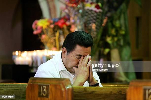 A man prays inside the Iglesia de la Placita at Nuestra Senora Reina de Los Angeles or Our Lady Queen of Angeles Church March 31 2005 in Los Angeles...