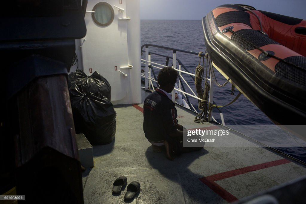 A man prays onboard the Migrant Offshore Aid Station (MOAS) Phoenix vessel enroute to Italy on June 11, 2017 off Catania, Italy. An estimated 230,000 refugees and migrants will arrive in Italy this year as numbers of refugees and migrants attempting the dangerous central mediterranean crossing from Libya to Italy continues to rise since the same time last year. So far this year more than 58,000 people have arrived in Italy and 1,569 people have died attempting the crossing. Libya continues to be the primary departure point for refugees and migrants taking the central mediterranean route to Sicily. In an attempt to slow the flow of migrants, Italy recently signed a deal with Libya, Chad and Niger outlining a plan to increase border controls and add new reception centers in the African nations, which are key transit points for migrants heading to Italy. MOAS is a Malta based NGO dedicated to providing professional search-and-rescue assistance to refugees and migrants in distress at sea. Since the start of the year MOAS have rescued and assisted more than 4000 people and are currently patrolling and running rescue operations in international waters off the coast of Libya.