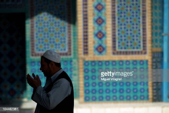 A man prays outside the Blue Mosque on September 26 2010 in MazareSharif Afghanistan The Shrine of Hazrat Ali known as the Blue Mosque is one of the...