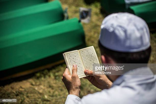 A man prays over the coffin before the mass funeral for 136 newlyidentified victims of the 1995 Srebrenica massacre attended by tens of thousands of...