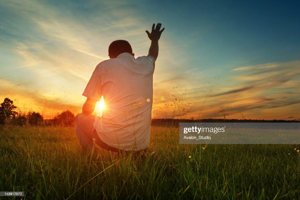 Man prays to God : Stock Photo