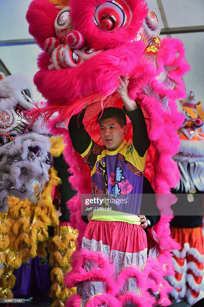 Man prepares a dragon as the Chinese community of Glasgow are dressed in traditional costumes to celebrate The Year of The Monkey on February 7, 2016 in Glasgow, Scotland. The first ever Chinese New Year celebrations to be held in George Square, The Year of the Monkey begins on February 8th and lasts until January 27, 2017.