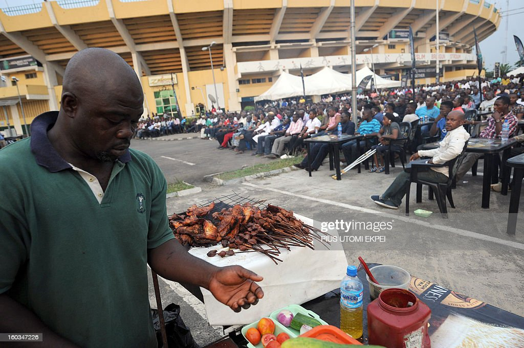 A man prepares barbecue popularly known as Suya for fans watching Nigeria's match with Ethiopia at a public viewing centre in Lagos January 29, 2013. Nigeria defeated Ethiopia 2-0 in Group C match played at Royal Bafokeng Stadium, Rustenburg to qualify for quater-finals of the 2013 Africa Cup of Nations in South Africa