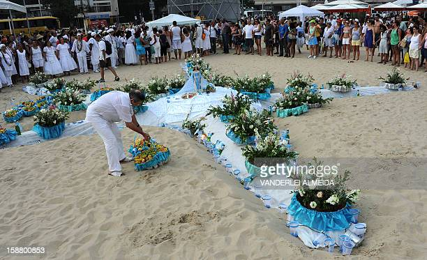 A man prepares fruit offerings for Iemanja goddess of the Ocean in AfricanBrazilian religions in Copacabana beach Rio de Janeiro Brazil on December...