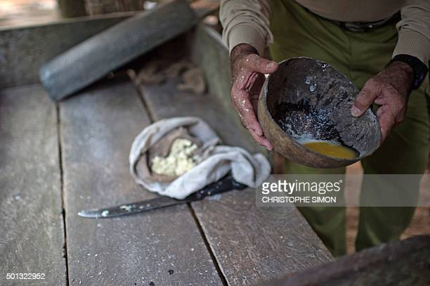 A man prepares tapioca crepe at a farm on the bank of the Rio Negro in the Amazonia Brazil on December 9 2015 AFP PHOTO / Christophe SIMON / AFP /...