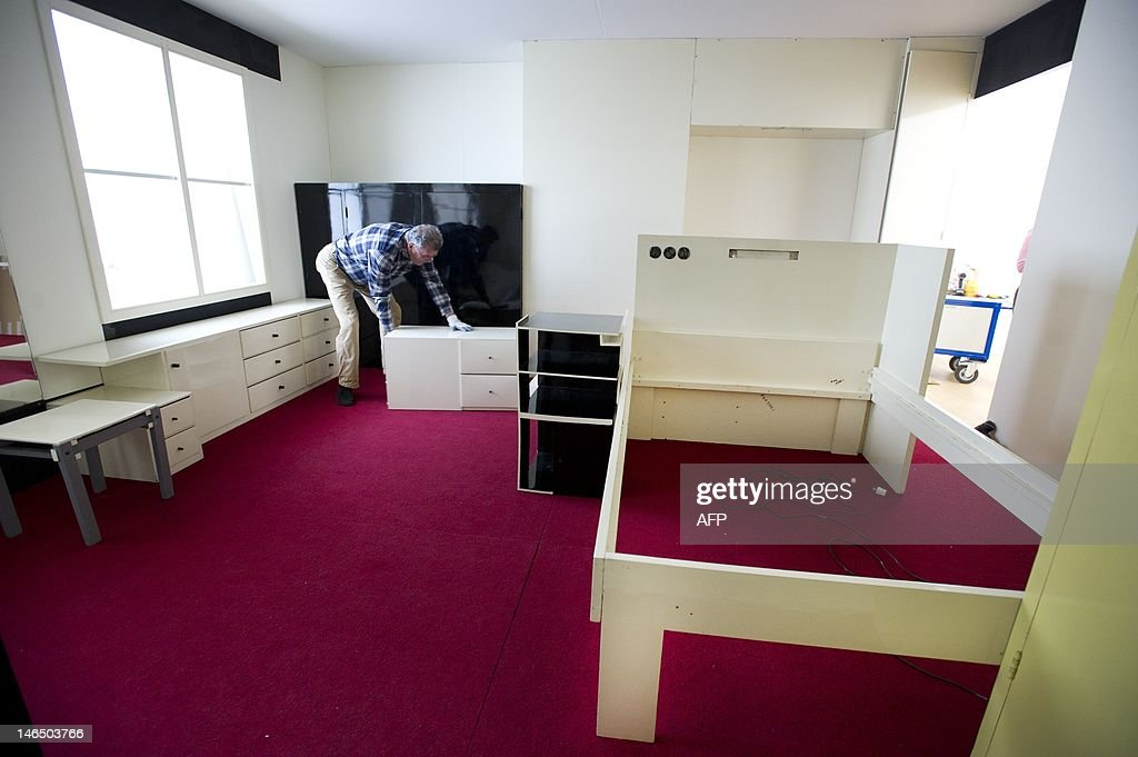A man prepares the Harrenstein bedroom Pictures Getty Images