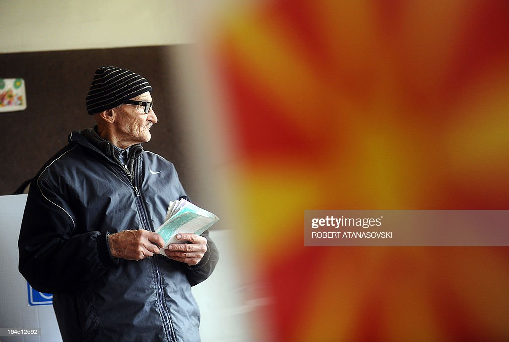 A man prepares to cast his ballot at a polling station in Skopje on March 24, 2013, as part of the local elections held against a backdrop of ethnic tensions, as a political crisis between the right-wing government majority and left-wing opposition rumbles on. AFP PHOTO / ROBERT ATANASOVSKI