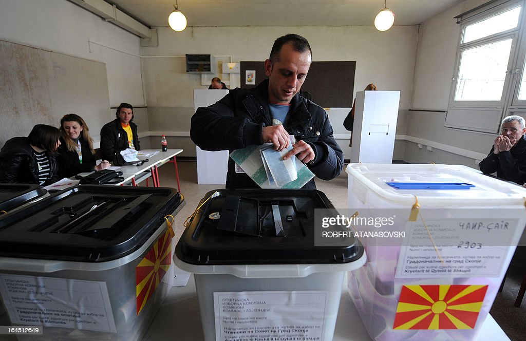 A man prepares to cast his ballot at a polling station in Skopje on March 24, 2013, as part of the local elections held against a backdrop of ethnic tensions, as a political crisis between the right-wing government majority and left-wing opposition rumbles on.