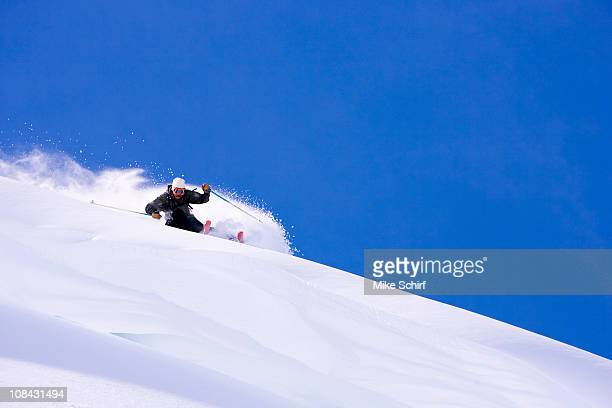 A man prepares to catch some air on a sunny day in Austria.