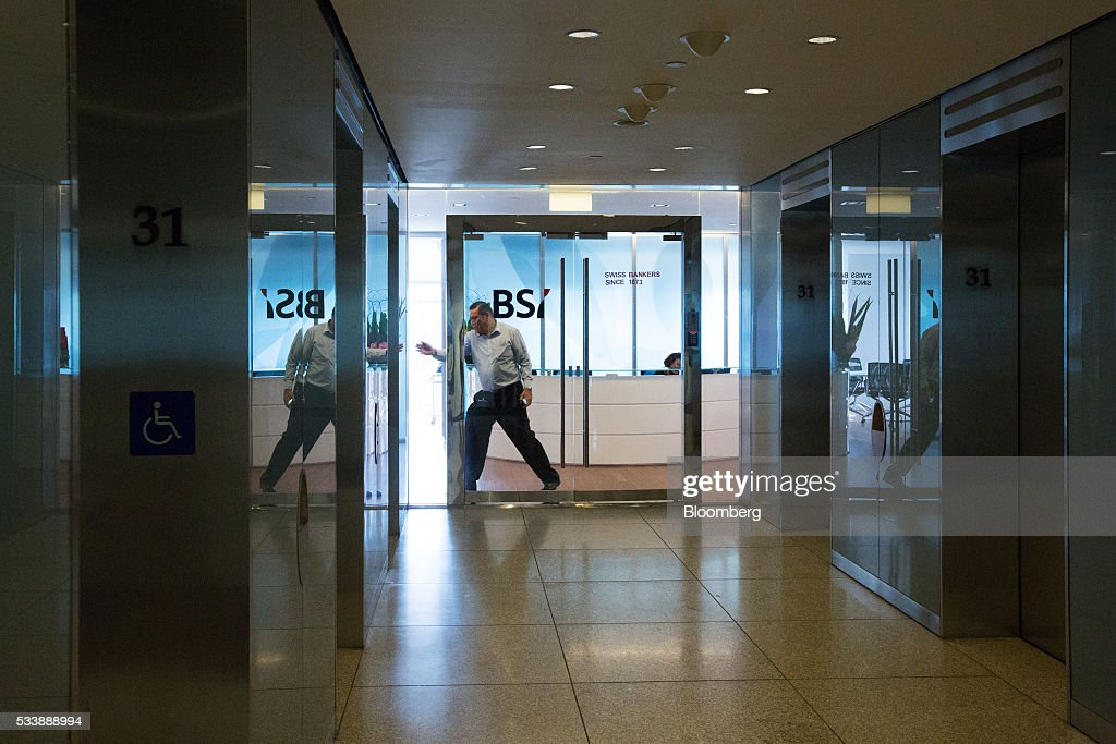A man prepares to exit the headquarters of BSI Bank Ltd. in Singapore, on Tuesday, May 24, 2016. Singapore ordered BSI's unit in the city-state to shut down as Swiss authorities began criminal proceedings against the bank, the biggest fallout suffered by a financial institution to date from global probes related to a troubled Malaysian state fund. Photographer: Nicky Loh/Bloomberg via Getty Images