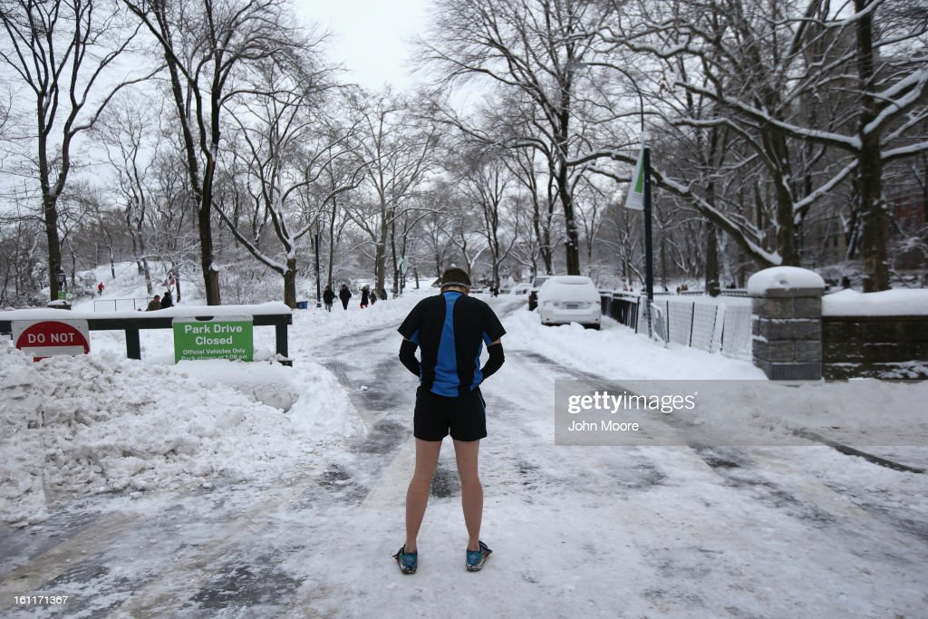 A man prepares to jog in Central Park on February 9, 2013 in New York City. The park received almost a foot of snow, as New York was spared the worst of the massive snow storm that hit the U.S. Northeast.