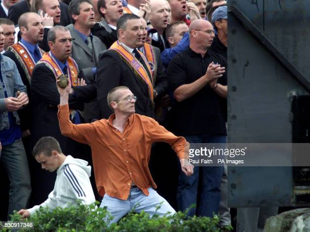A man prepares to throw a brick at police as Portadown Orangemen clash with riot police after the men had broken through a metal barrier at Drumcree...