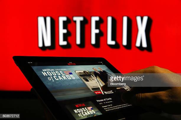 A man prepares to watch House Of Cards on the Netflix Inc application on a tablet device in this arranged photograph in London UK on Tuesday Jan 5...