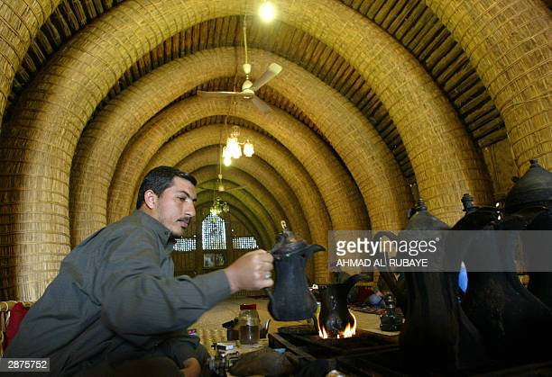 A man prepares tradtional Arab coffee in a mudif a typically southern Iraqi meeting hall made entirely of reeds from the surrounding marshes in the...