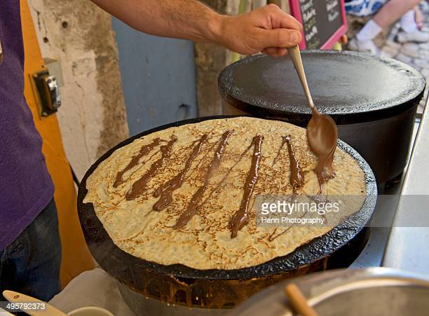 Man preparing a french crepes with chocolate sauce in La Palud at the Verdon Gorge in south France