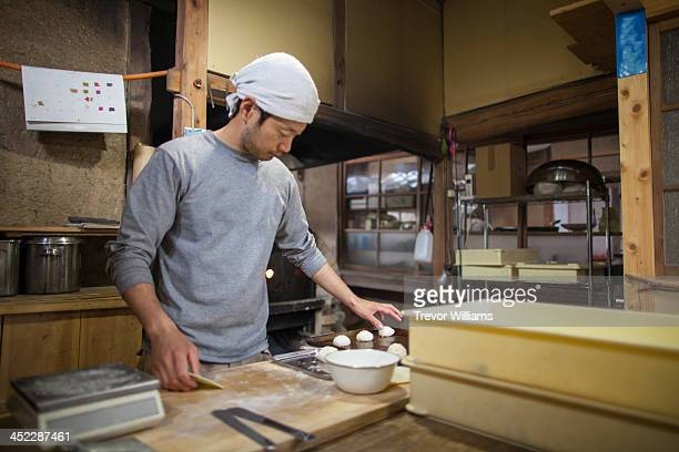 Man preparing dough for baking