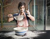 Man preparing flour for baking
