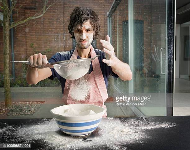 Man preparing flour for baking