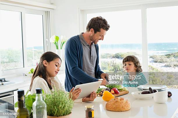 Man preparing food for his children