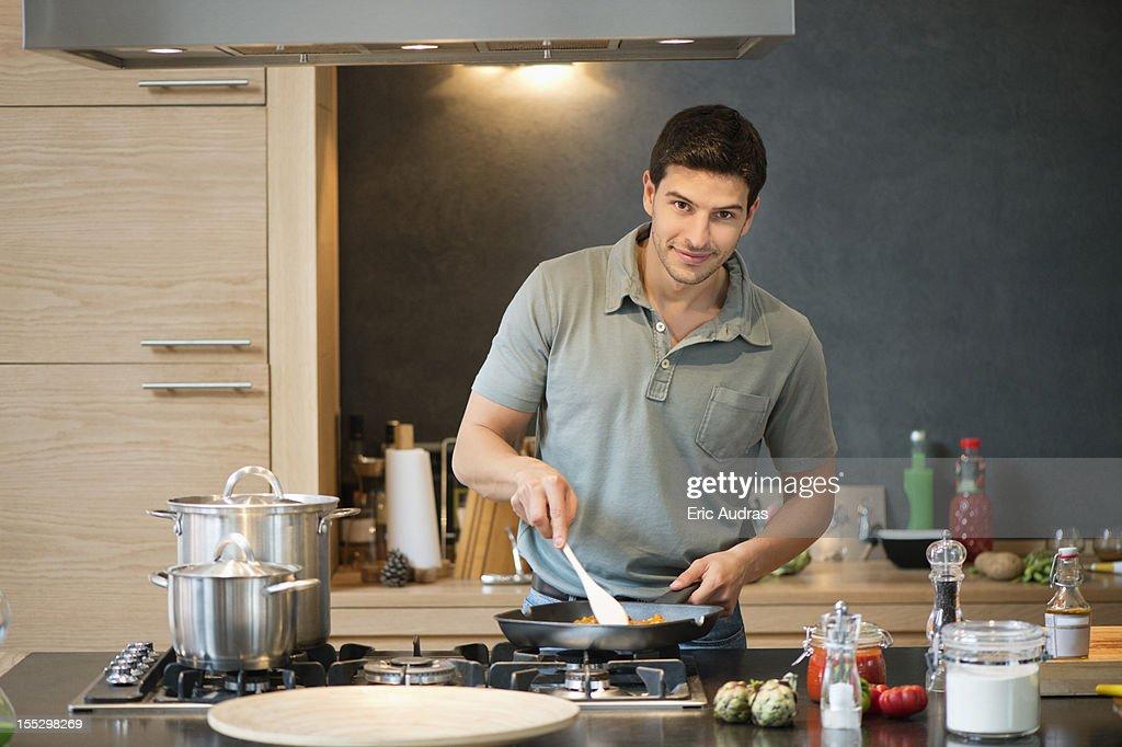 Man preparing food in the kitchen : Stock Photo