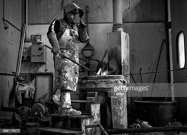 Man preparing for bronze casting.
