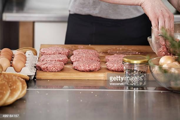 Man preparing meatballs in kitchen
