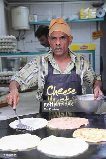 Man preparing pancakes in Jeddah, Saudi Arabia