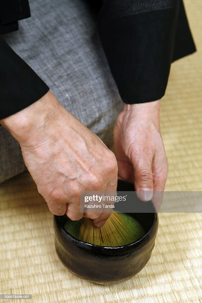 Man preparing tea for tea ceremony, close-up : Stock Photo