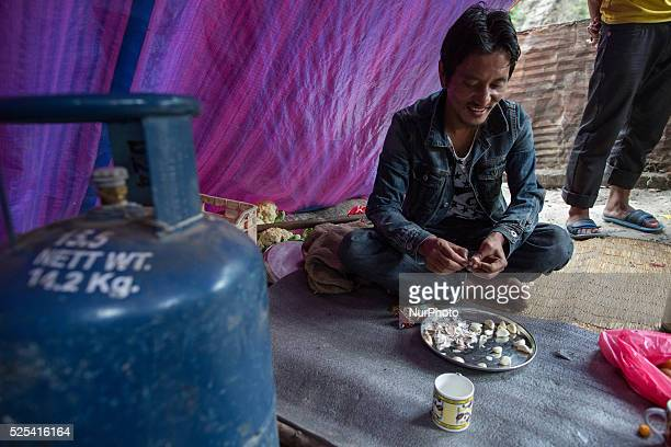 Man preparing the food for 20 people as they can survive only 2 more weeks with their food stock on the Araniko Road near the Kobani Village Isolated...