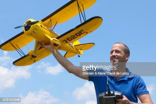 Man preparing to launch model plane