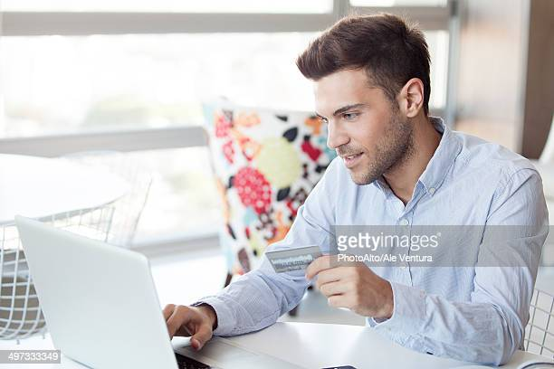 Man preparing to make online purchase using credit card