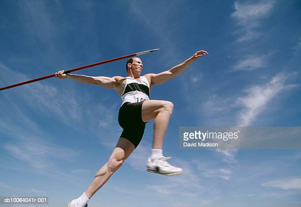 Man preparing to throw javelin at track and field competition