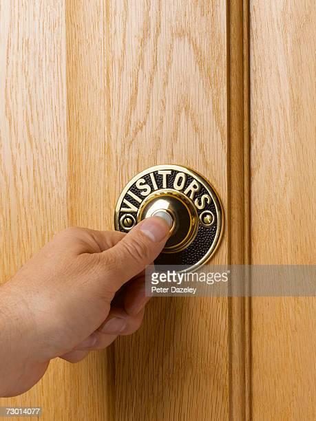 Man pressing doorbell, close-up