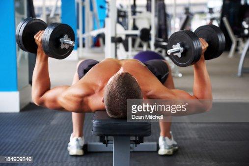 Man Pressing Dumbbells : Stock Photo