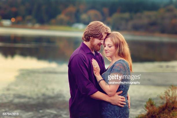 Man pressing his forehead to woman's forehead