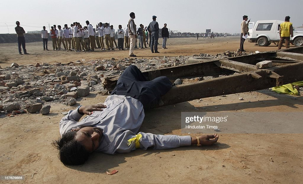 A man pretending to be dead during a mock drill session at Burari ground on December 4,2102 in New Delhi, India. Mock Drill performs at various place in the capital to test the alertness and responds during the time of emergency situation such as Earthquake, Fire, Bomb Blast.