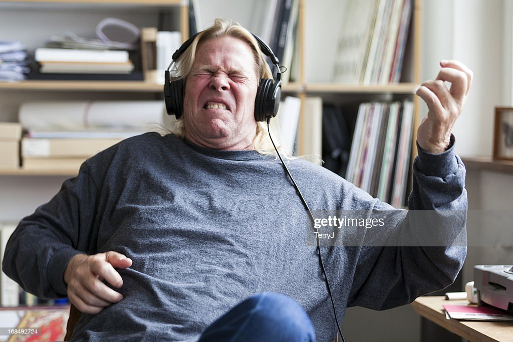 Man Pretends to Play Guitar Listening to Music