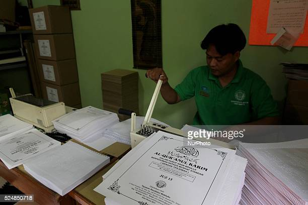 A man printing a Braile Quran at Raudlatul Makfufin Foundation in Tangerang outskrit of Jakarta Indonesia on June 24 2015 Braille Quran is the...