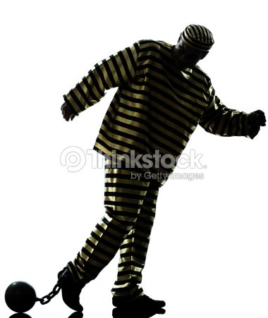 man prisoner criminal with chain ball silhouette stock photo