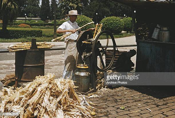 A man processing sugar cane in Sao Paulo Brazil circa 1960