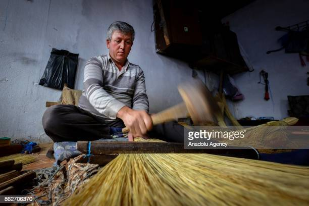 A man produces brooms at Alibeyli village of Carsamba district in Samsun Turkey on October 18 2017 The village dwellers who learn making brooms from...