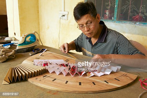 Man produces traditional Chinese fan in Yangshuo, China. : Stock Photo