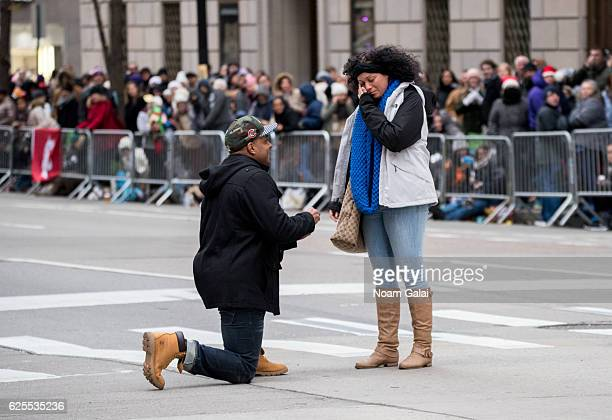 A man proposes to his girlfriend at the 90th Annual Macy's Thanksgiving Day Parade on November 24 2016 in New York City