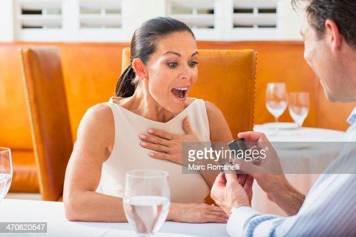 Man proposing to girlfriend at restaurant