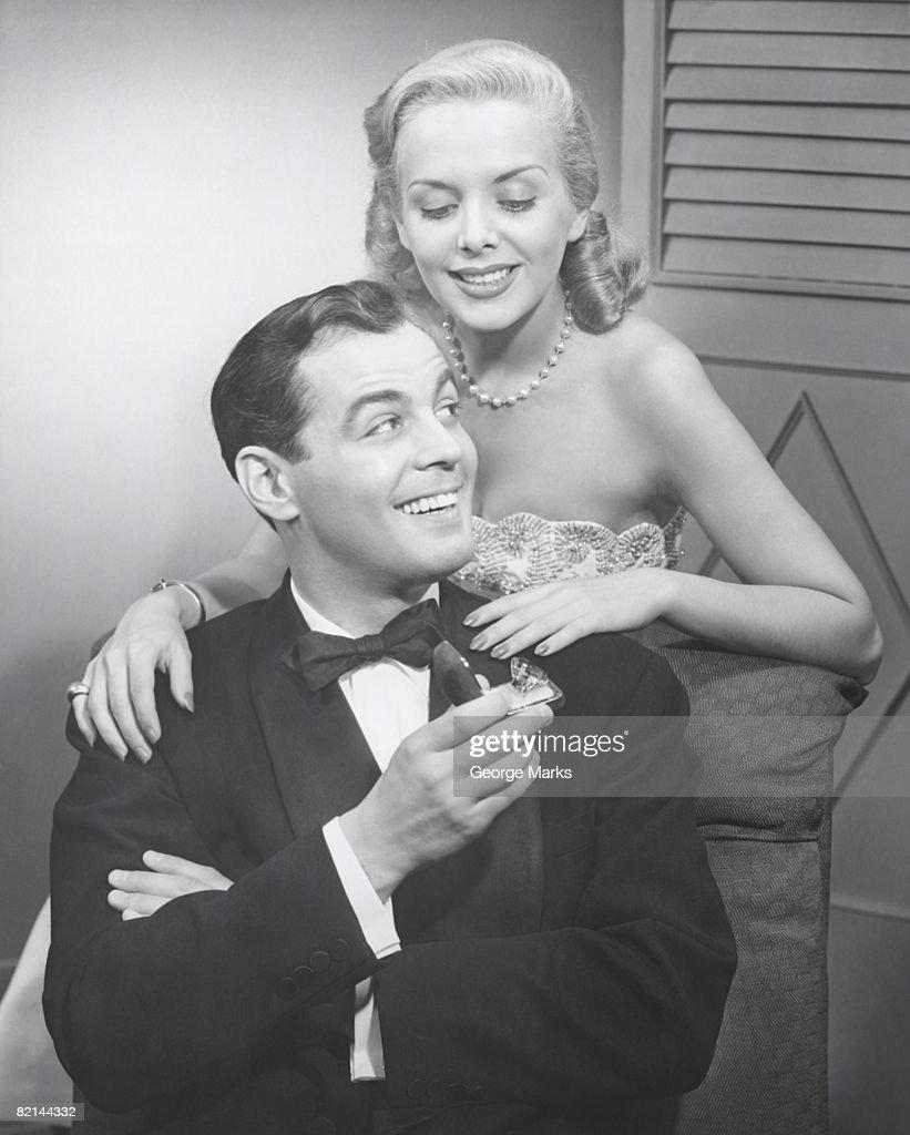 Man proposing to woman, (B&W), : Stock Photo