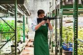 Man protecting his marijuana business with a rifle