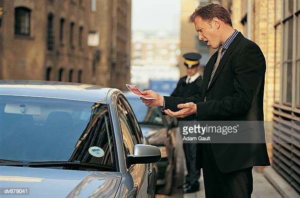 Man Protesting at Parking Ticket in Front of Traffic Warden