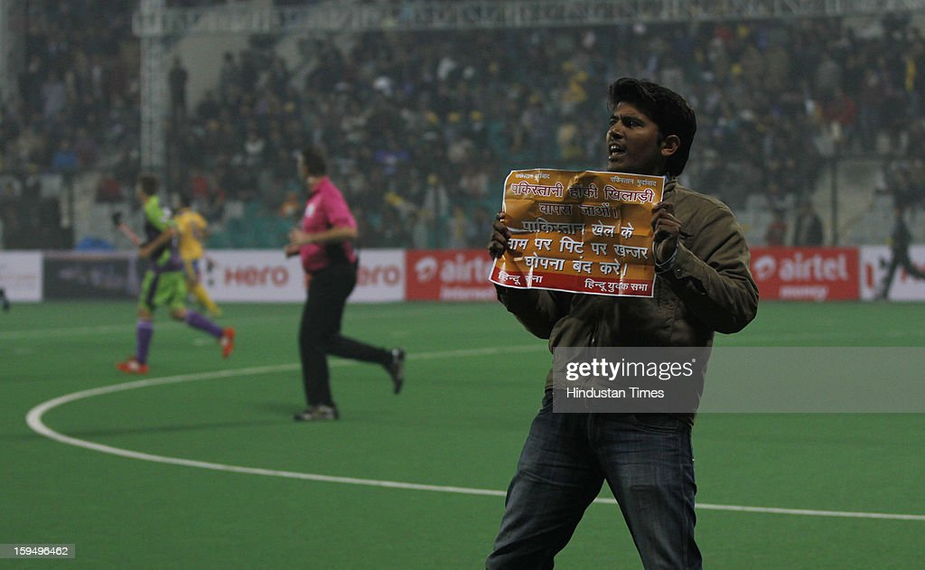 A man protests against Pakistan troops' brutal killing of Indian soldiers, while the first match of Hockey India League is in progress between Delhi Waveriders and Punjab Warriors at Major Dhyan Chand Stadium on January 14, 2013 in New Delhi, India. Hockey India League is a professional league for field hockey competition comprising five franchisee-based teams consisting of players from India and around the world. The entire event takes place on home and away basis culminating into multi header playoffs.