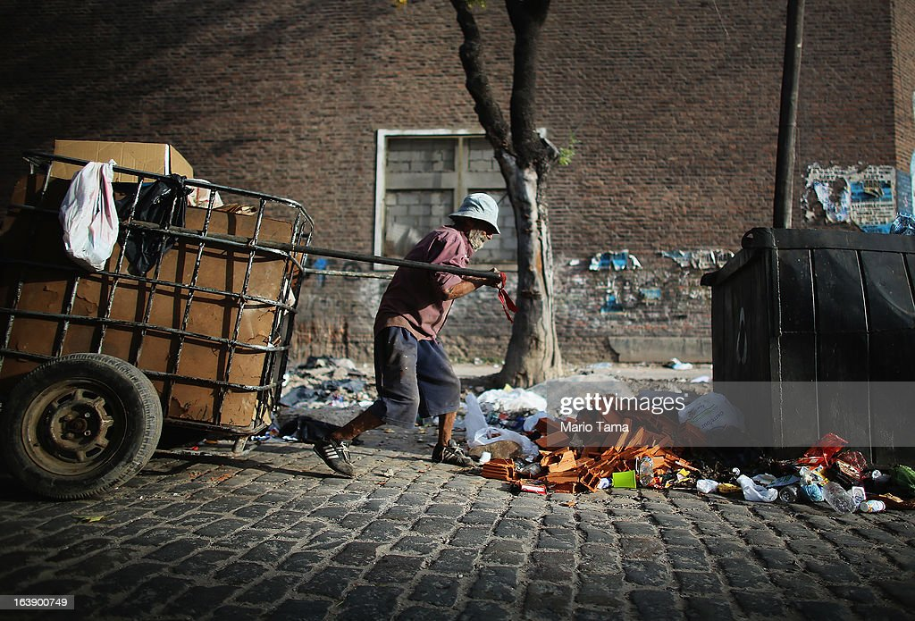 A man pulls a cart with recyclables he has collected to exchange for money near the Virgin of the Miracles of Caacupe church following Sunday Mass in the Villa 21-24 slum, where archbishop Jorge Mario Bergoglio, now Pope Francis, used to perform charity work, on March 17, 2013 in Buenos Aires, Argentina. Francis was the archbishop of Buenos Aires and is the first Pope to hail from South America. Some locals are now affectionately calling Francis, known for his charity work in the slums, the 'slum pope.'
